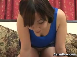 Cute Asian Girl Spitting On A Table