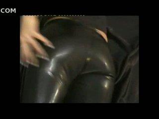 סקסי נערה ב הדוקה עור pants