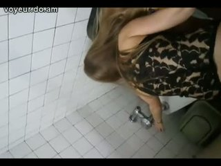Girl Trying To Put On Pants In Disco Toilet
