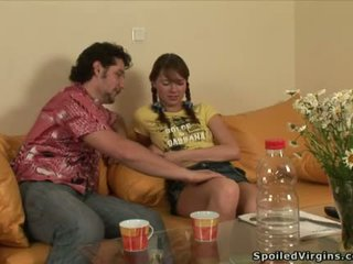 Young darling is pleasuring two coarse dongs