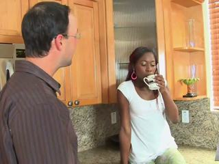 Sexy ebony teen with braids gives white saussage a blowjob in kitchen