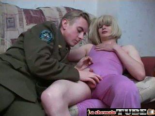 Crossdressing in purple dress pleases her man