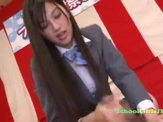 Sexy Asian schoolgirl jerking off her mans cock