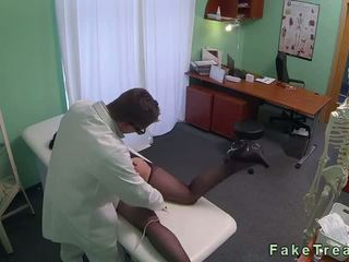 Brunette rubs pussy at her doctor