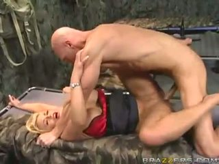 Busty blonde in army gets her huge boobies covered with cum