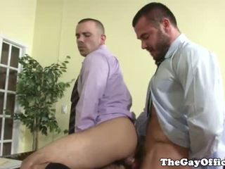 Horny muscular hunks sucking in office