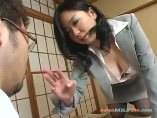 Busty Asian milf gets her big tits and...