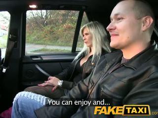 FakeTaxi Big tits blonde fucks partner on taxi backseat
