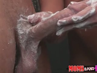 Mature Diana Doll gives a hand job in the shower