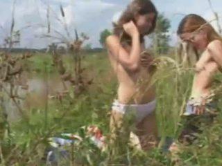 Lesbian teen amateurs in the grass
