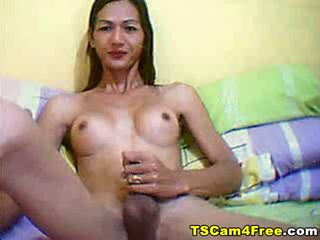 Watch this scene of a Asian Shemale show her