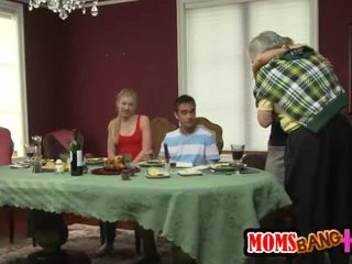 MILF Stroks a Young Cock Under the Table