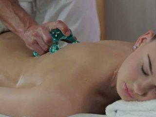 Masseur licks and fucks hot brunette on massage