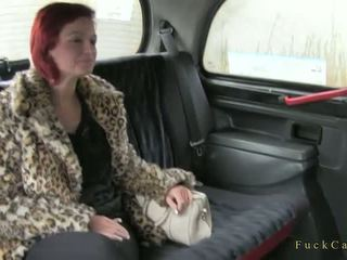 Busty redhead amateur banged in a backseat in fake taxi