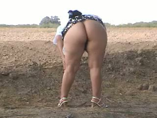 Piss Fat ass pee in street. Bebita mex...
